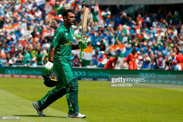 Pakistan's Fakhar Zaman gestures as he walks back to the pavilion after losing his wicket for 114 during the ICC Champions Trophy final cricket match...