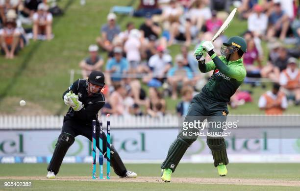 Pakistan's Fakhar Zaman is dismissed as New Zealand's Tom Latham looks on during the fourth oneday international cricket match between New Zealand...