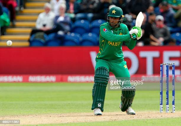 Pakistan's Fakhar Zaman prewpares to play a shot to be caught out for 50 runs by Sri Lanka's Asela Gunaratne during the ICC Champions Trophy match...