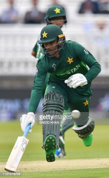 Pakistan's Fakhar Zaman runs between the wickets with Pakistan's ImamulHaq during the 2019 Cricket World Cup group stage match between Pakistan and...
