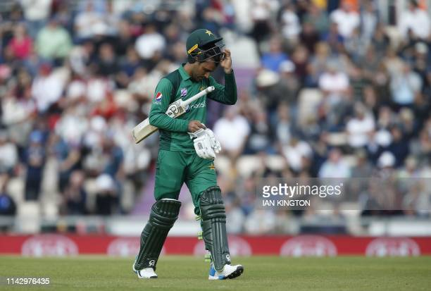 Pakistan's Fakhar Zaman walks back to the pavilion after losing his wicket for 138 runs during the second One Day International cricket match between...
