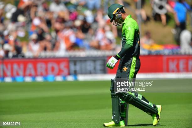 Pakistan's Fakhar Zaman walks from the field after being caught during the 5th oneday international cricket match between New Zealand and Pakistan at...