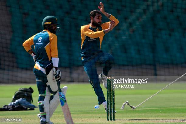 Pakistan's Fawad Alam and Faheem Ashraf attend a practice session at the National Stadiumin Karachi on January 22 ahead of their first cricket test...
