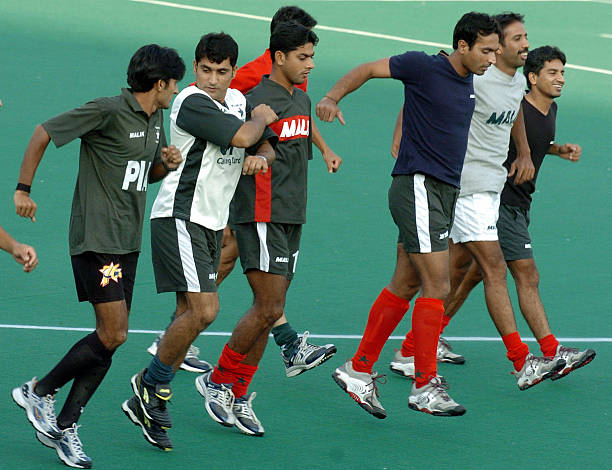 Pakistan`s field hockey players run during a practice session in Chandigarh 05 October 2004 Indian and Pakistan will play the sixth match of their...