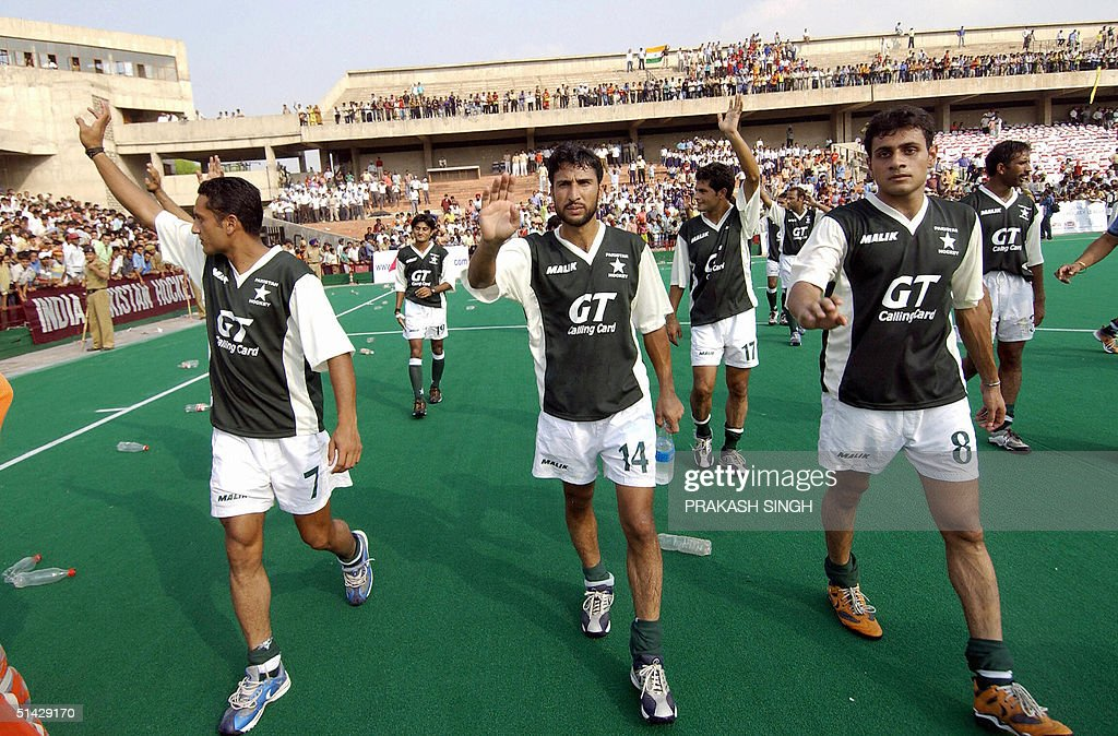 Pakistan`s field hockey players wave to the crowd following the sixth match of the Friendship series between India and Pakistan in Chandigarh 06...