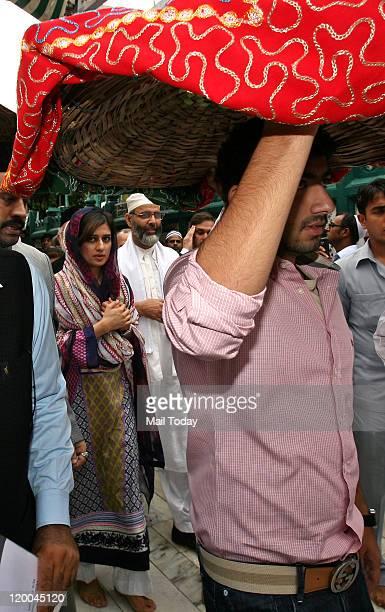 Pakistan's Foreign Minister Hina Rabbani Khar arrives to offer prayers at mausoleum of the revered Sufi saint Hazrat Nizamuddin Auliyaa in New Delhi...