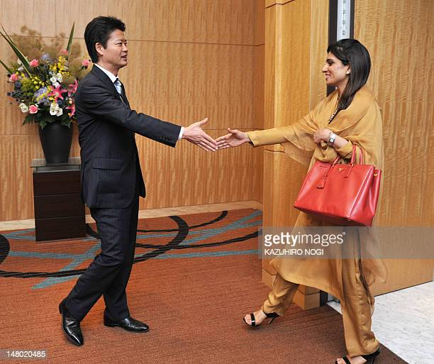 Pakistan's Foreign Minister Hina Rabbani Khar is greeted by her Japanese counterpart Koichiro Gemba prior to their talks at a hotel in Tokyo July 8...