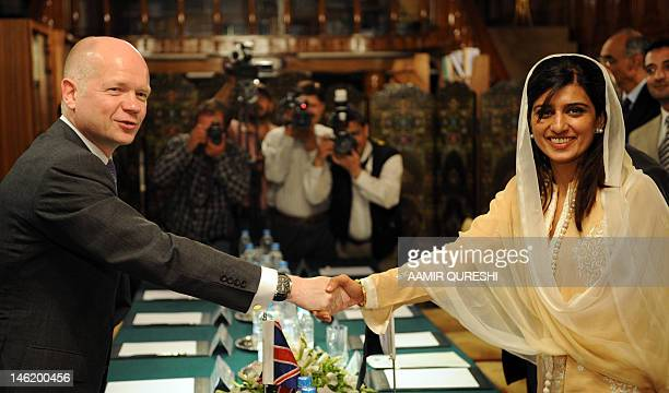 Pakistan's Foreign Minister Hina Rabbani Khar shakes hands with Britain's Foreign Secretary William Hague prior to a meeting in Islamabad on June 12...