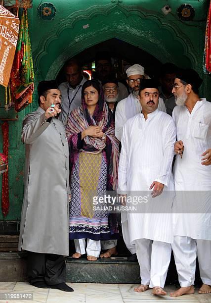 Pakistan's Foreign Minister Hina Rabbani Khar visits the shrine of Muslim Sufi saint Hazrat Nizamuddin Aulia in New Delhi on July 28 2011 India and...