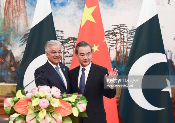 Pakistans Foreign Minister Khawaja Muhammad Asif and Chinese State Councilor and Foreign Minister Wang Yi pose after their press conference at the...