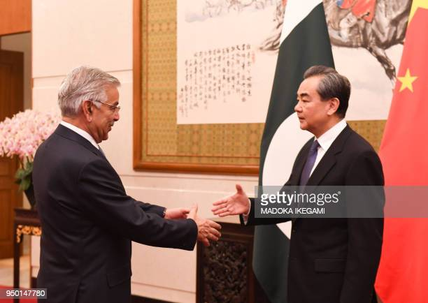 Pakistans Foreign Minister Khawaja Muhammad Asif meets Chinese State Councilor and Foreign Minister Wang Yi at the Diaoyutai State Guest House in...