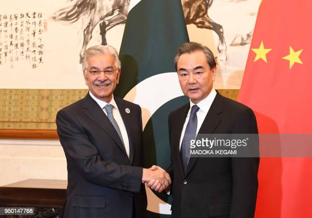 Pakistans Foreign Minister Khawaja Muhammad Asif shakes hands with Chinese State Councilor and Foreign Minister Wang Yi at the Diaoyutai State Guest...