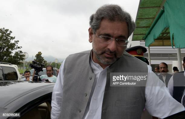 Pakistan's former petroleum minister and prime minister designate Shahid Khaqan Abbasi leaves after a meeting at Parliament House in Islamabad on...