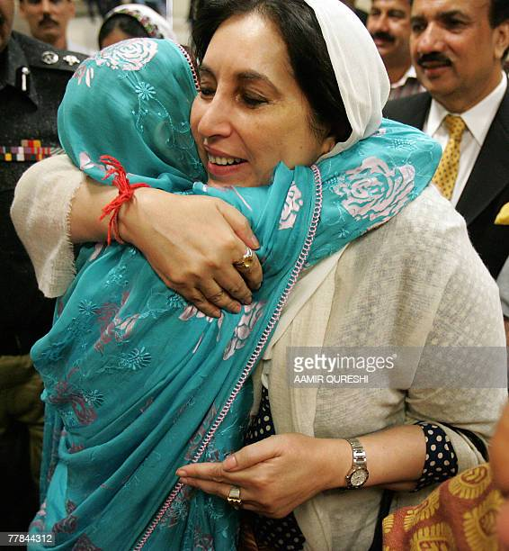 Pakistan's former prime minister Benazir Bhutto greets a supporter upon her arrival at the Lahore International Airport in Lahore 11 November 2007...