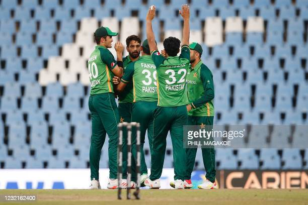 Pakistan's Haris Rauf celebrates with teammates after the dismissal of South Africa's Kyle Verreynne during the third one-day international cricket...