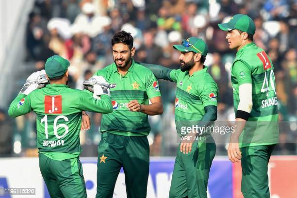 Pakistan's Haris Rauf celebrates with teammates the wicket of Bangladesh's Mahmudullah Riyad during the second T20 international cricket match of a...