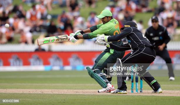 TOPSHOT Pakistan's Haris Sohail bats as New Zealand's Tom Latham looks on during the fourth oneday international cricket match between New Zealand...