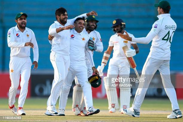 Pakistan's Haris Sohail celebrates with teammates after taking the wicket of Sri Lanka's Niroshan Dickwella during the fourth day of the second Test...
