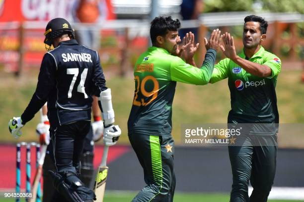 Pakistan's Hasan Ali celebrates bowling New Zealand's Mitchell Santner with teammate Shadab Khan during the third one day international cricket match...