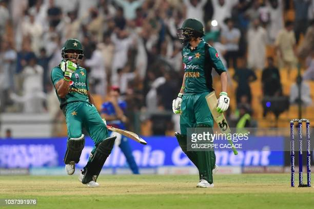 Pakistan's Hasan Ali celebrates with Shoaib Malik at the end of the match during the one day international Asia Cup cricket match between Pakistan...