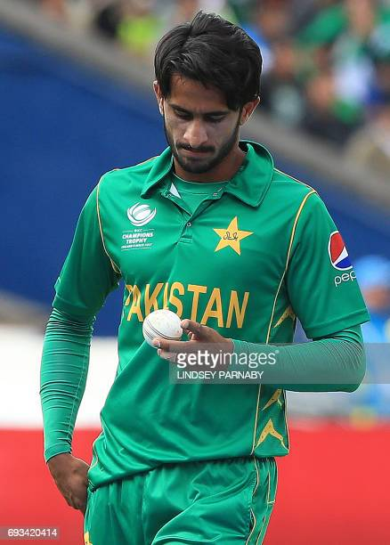 Pakistan's Hasan Ali inspects the ball during the ICC Champions trophy match between Pakistan and South Africa at Edgbaston in Birmingham on June 7...