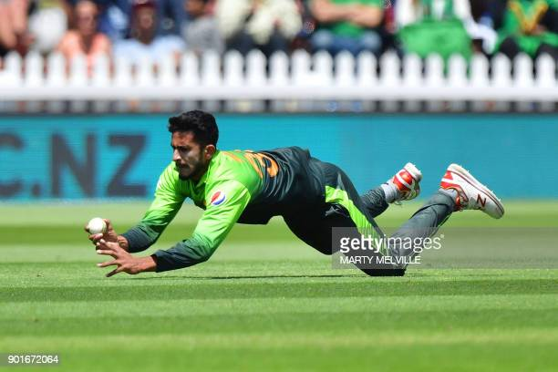 TOPSHOT Pakistan's Hasan Ali takes the catch of New Zealand's captain Kane Williamson during the first one day international cricket match between...