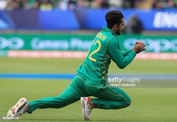 Pakistan's Hasan Ali takes the catch to dismiss South Africa's Kagiso Rabada off the bowling of Pakistan's Junaid Khan during the ICC Champions...