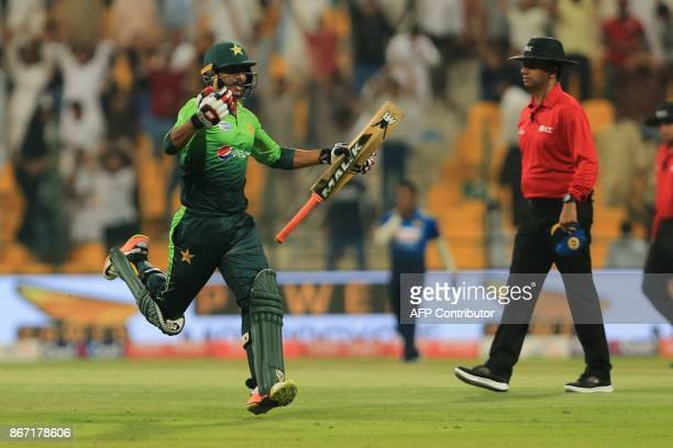 Pakistan's Hassan Ali celebrates match winning run between the wicket during the second Twenty20 series cricket match Pakistan vs Sri Lanka on...