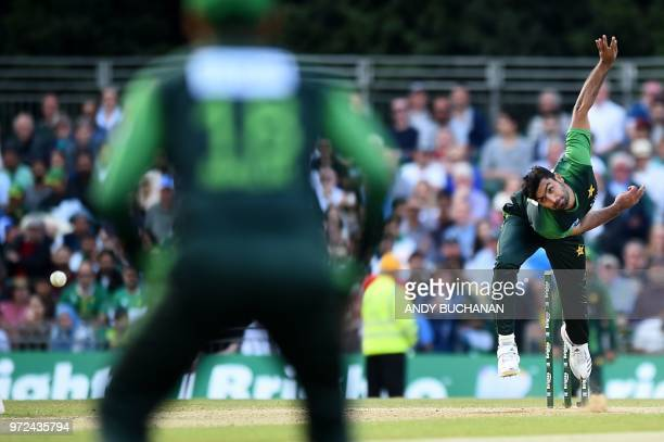 TOPSHOT Pakistan's Hussain Talat bowls during the first Twenty20 International cricket match between Scotland and Pakistan at the Grange Cricket Club...