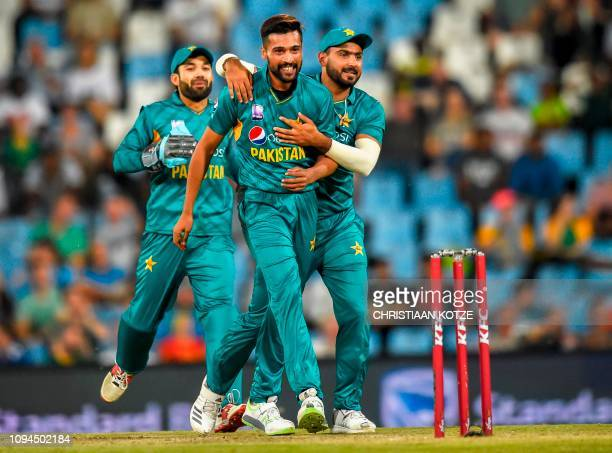 Pakistan's Hussain Talat celebrates with Pakistan's Mohammad Amir after taking the wicket of South Africa's Heinrich Klaasen during the third and...