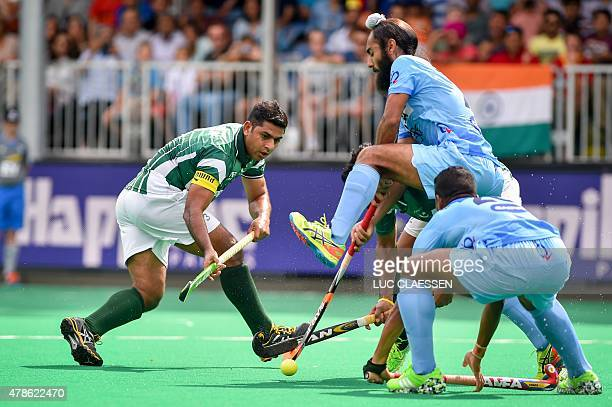 Pakistan's Imran Muhammad vies with India's players during the Group A field hockey match between Pakistan and India of the men's group stage of the...