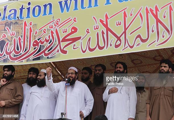 Pakistan's JamatudDawa chief Hafiz Saeed addresses during a protest rally against Israeli military strikes on the Gaza Strip in eastern Pakistan's...