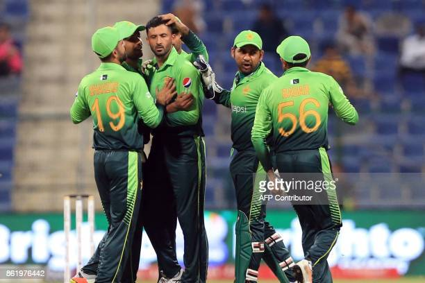 Pakistan's Junaid Khan celebrates after dismissing Sri Lanka's Niroshan Dickwella leaves the field during the second one day international cricket...