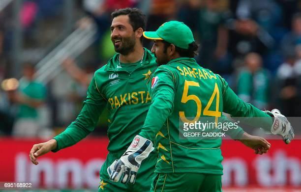Pakistan's Junaid Khan celebrates with Pakistan's Sarfraz Ahmed after taking the wicket of Sri Lanka's Thisara Perera for 1 run during the ICC...