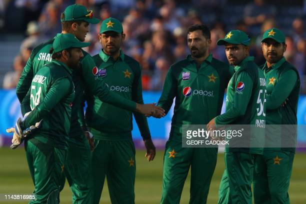 Pakistan's Junaid Khan celebrates with team mates after taking the wicket of England's Jonny Bairstow during the third One Day International cricket...