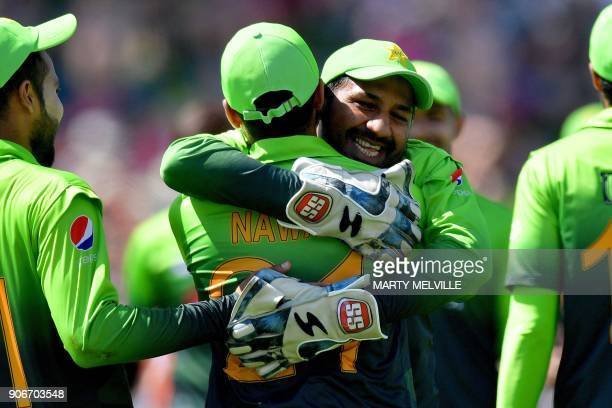 Pakistan's keeper Sarfraz Ahmed and teammate Mohammad Nawaz celebrate New Zealand's Colin Munro being caught during the 5th one day international...