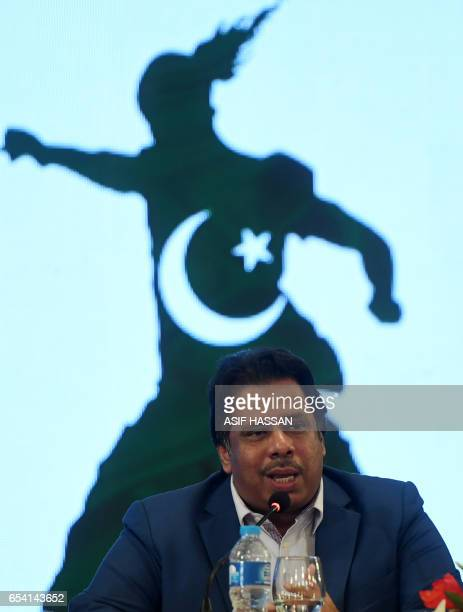 Pakistan's legendary squash player Jahangir Khan speaks during a press conference with representatives of the Leisure Leagues and athletes on March...