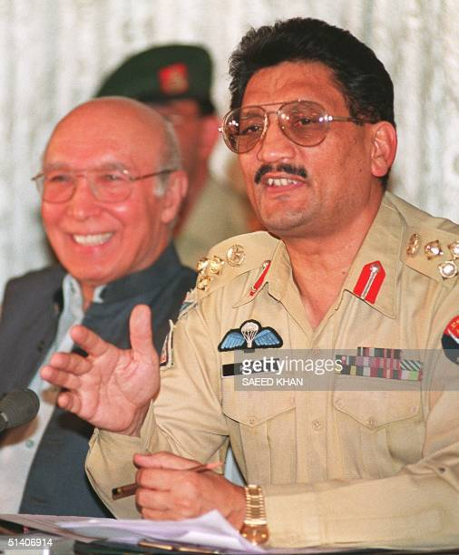 Pakistan's military spokeman Brigadier Rashid Qureshi along with foreign minister Sartaj Aziz speaks at a press conference after the meeting of...