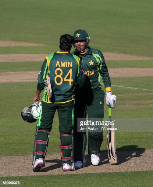 Pakistan's Misbah ul Haq celebrates with teammate Umar Amin fter winning the match during the ICC Champions Trophy Warm Up Match at The Kia Oval...