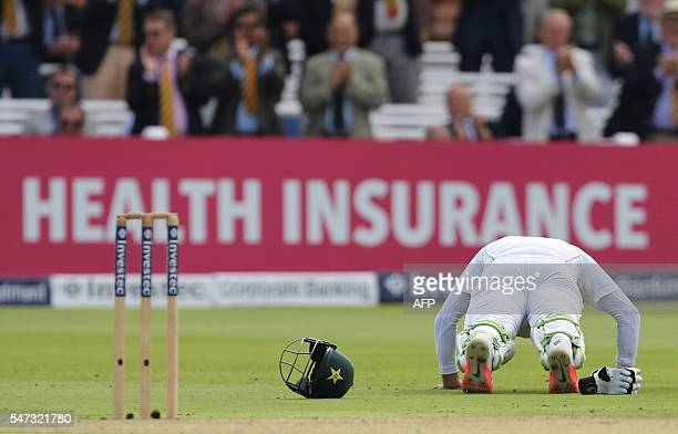 Pakistan's MisbahUlHaq celebrates his century by doing a few pressups on the first day of the first Test cricket match between England and Pakistan...