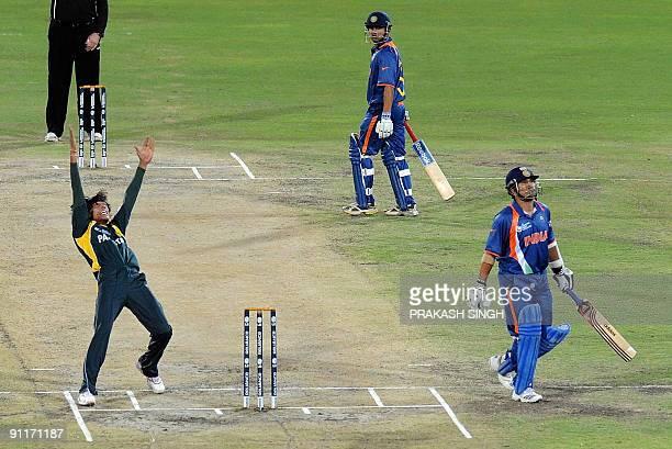 Pakistan's Mohammad Aamir celebrates the wicket of India's Sachin Tendulkar as Gaautam Gambhir looks on during the ICC Champions Trophy group match...