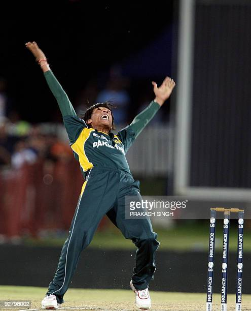 Pakistan's Mohammad Aamir celebrates the wicket of India's Sachin Tendulkar during the ICC Champions Trophy group match between India and Pakistan at...