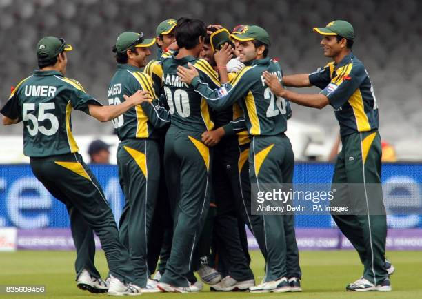 Pakistan's Mohammad Aamir is congratulated after Ahmed Shahzaib caught Sri Lanka's TM Dilshan during the Final of the ICC World Twenty20 at Lords...