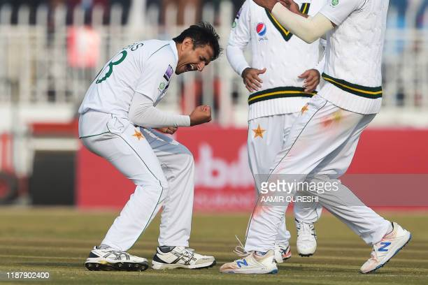 TOPSHOT Pakistan's Mohammad Abbas celebrates after bowing out Sri Lanka's Dinesh Chandimal during the first day of the first Test cricket match...