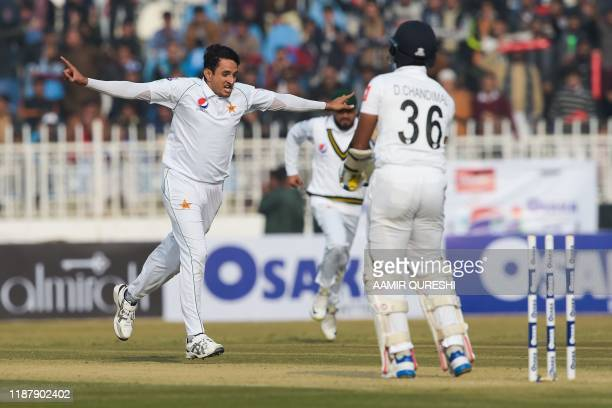 Pakistan's Mohammad Abbas celebrates after bowing out Sri Lanka's Dinesh Chandimal Pakistan's Mohammad Abbas celebrates the dismissal of Sri Lanka's...