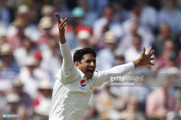 Pakistan's Mohammad Abbas celebrates taking the wicket of England's Alastair Cook for one on the third day of the first international Test match...