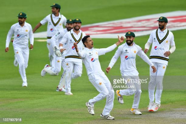 Pakistan's Mohammad Abbas celebrates with teammates after bowling England's Ben Stokes for 0 during play on the second day of the first Test cricket...