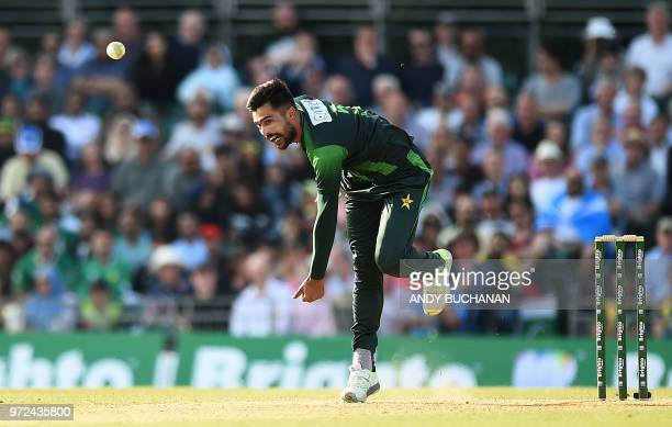 Pakistan's Mohammad Amir bowls during the first Twenty20 International cricket match between Scotland and Pakistan at the Grange Cricket Club in...
