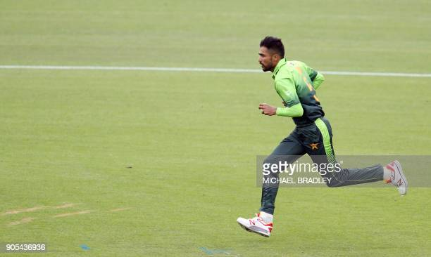 Pakistan's Mohammad Amir bowls during the fourth oneday international cricket match between New Zealand and Pakistan at Seddon Park in Hamilton on...