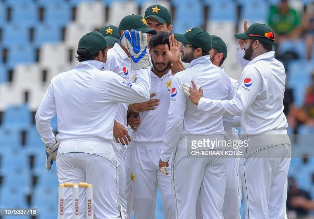 Pakistan's Mohammad Amir celebrates after getting the wicket of South Africa's Aiden Markram during day three of the 1st cricket test match between...
